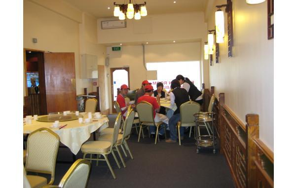 People eating at a seafood restaurant in Auckland