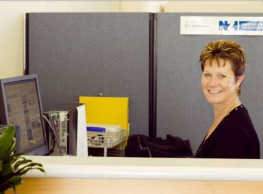 woman with insurance forms in Pukekohe