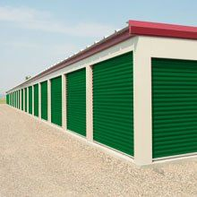 Green and beige outdoor self storage units
