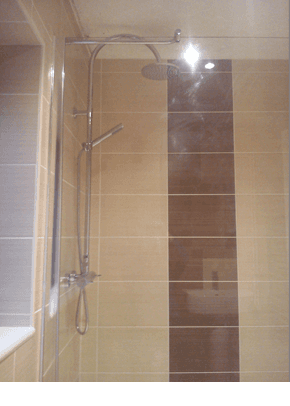 stylish shower with brown and creme tiles