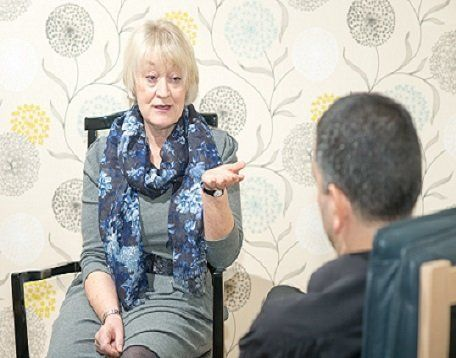 Therapist and patient in a one-to-one counselling session