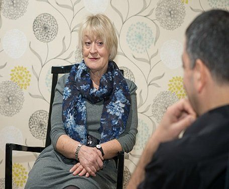 Therapist talking to a male patient