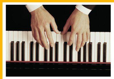 man playing the keyboard