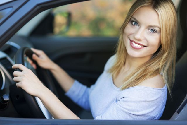 A happy driver using her new drivers license