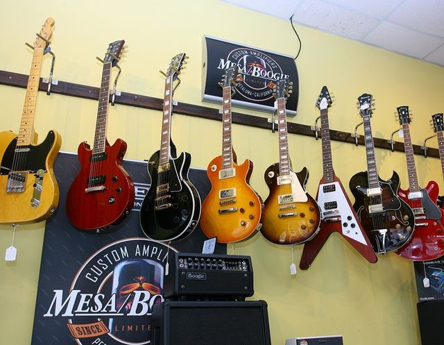 yellow and red guitars
