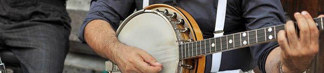 a man playing the banjo