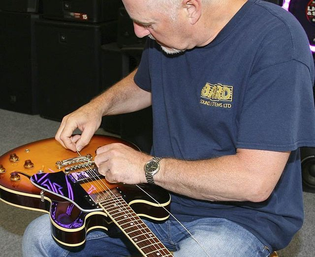 guitar being repaired