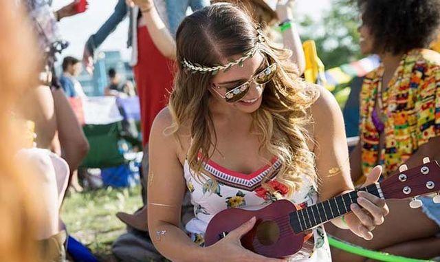 a lady playing ukulele