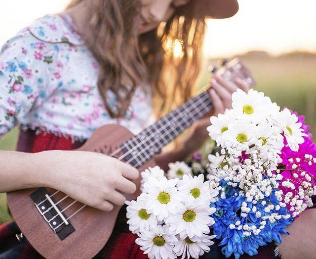 a woman playing ukulele