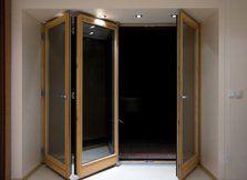 Bi-fold doors with wood frames