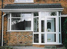 A white porch with bay window