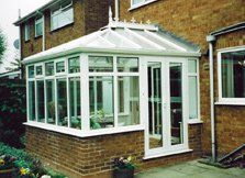 A white conservatory with double doors