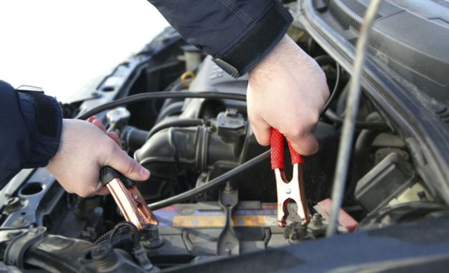 mechanic performing electrical services