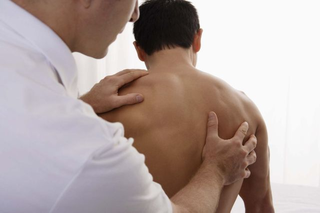 Chiropractor works on spine alignment with a patient in our chiropractic center in Aiea, HI