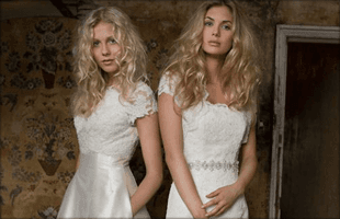 Two blonde girls in bridal style dresses