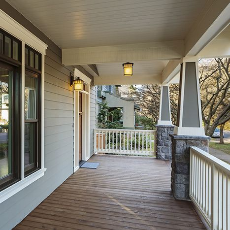 Beautiful house with a porch add-on after deck remodeling in Lakeville