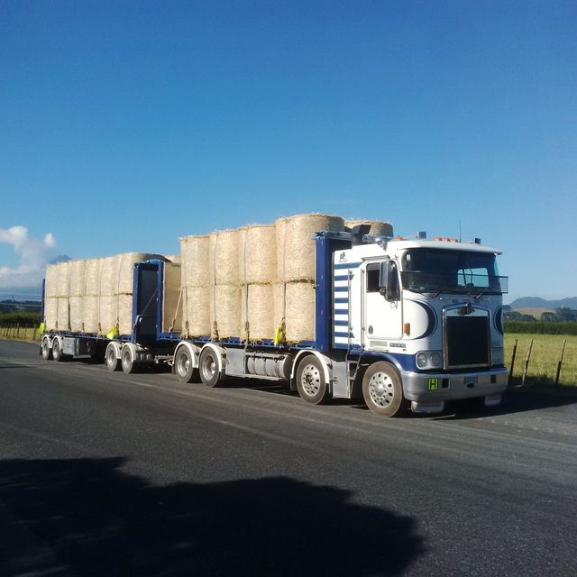 Truck in Taranaki carrying hay for farmers