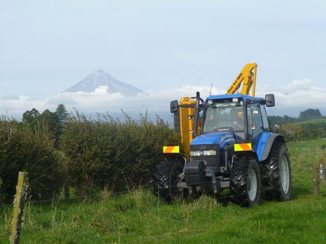Members of our farm management team at work in Taranaki
