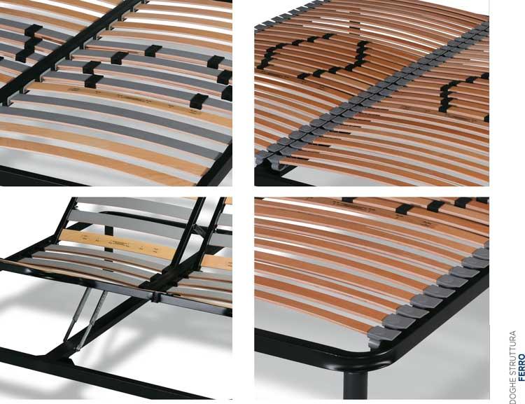 un letto con struttura in ferro e delle doghe in legno
