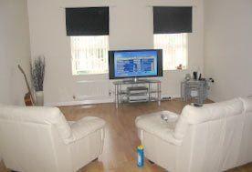 white coloured sofas