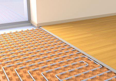 Split view of wooden floor and underfloor heating in the Scottish Borders