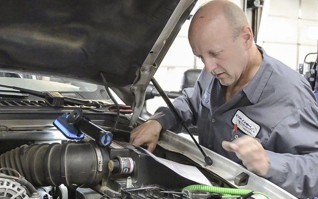Auto mechanic working on a car at Colchin Automotive