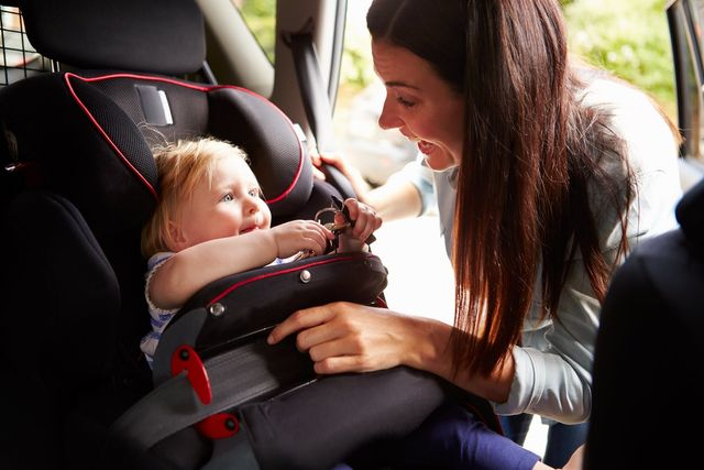 Mom smiling at baby in car