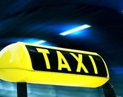Lit up taxi sign