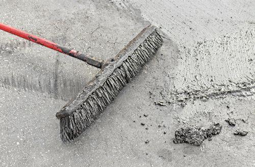 Professional preparing for concrete resurfacing