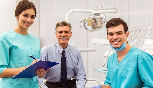 senior man in the dental surgery with the dentist