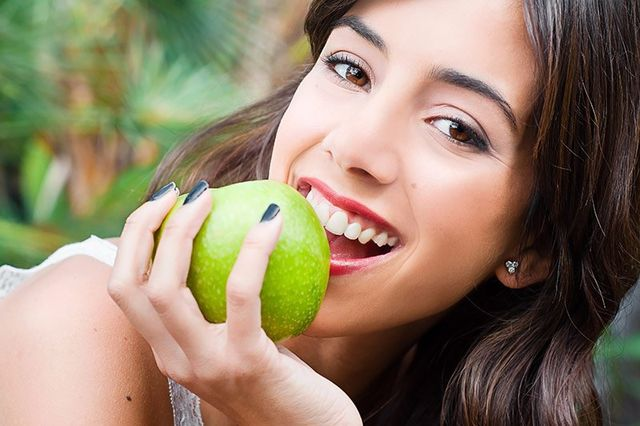 girl with apple smiling