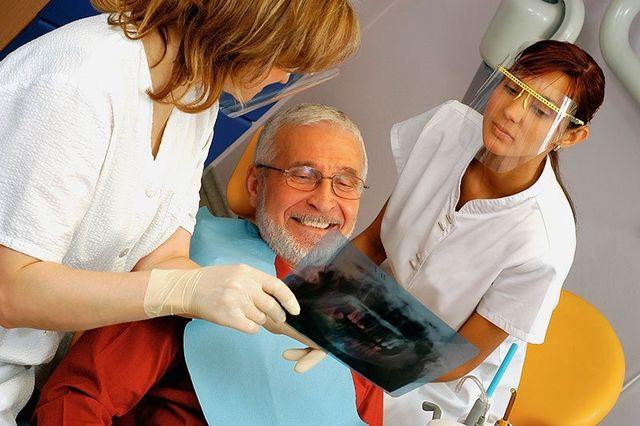 Senior receiving dental treatment