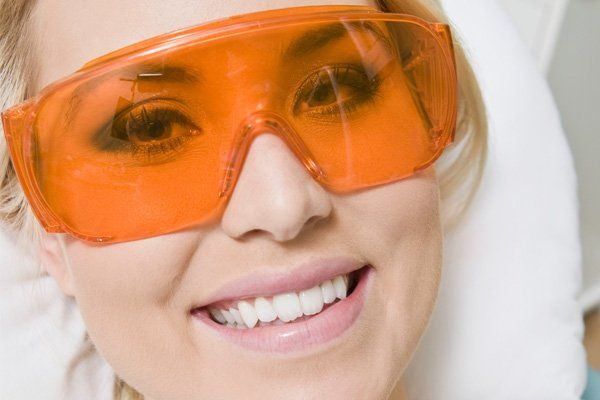 woman with orange glasses on smiling