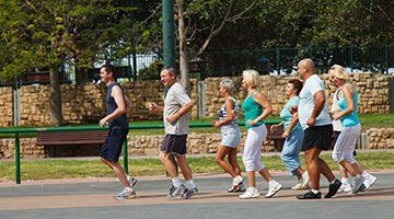 a group of people running in the park