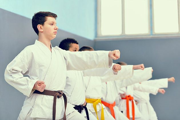 young kids practicing karate