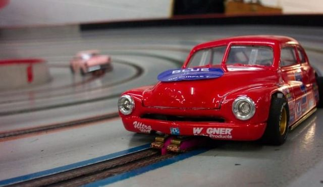 Picture of a red slot car on a slot car race track