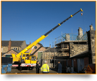 A long-reaching crane on-site in Darlington.