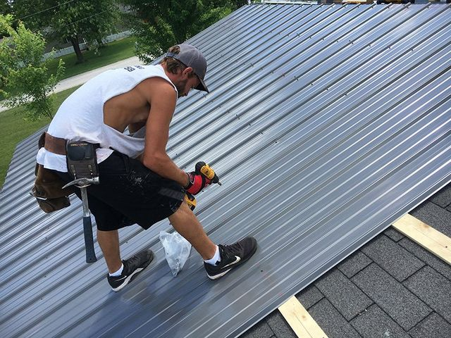 Man installing metal roof