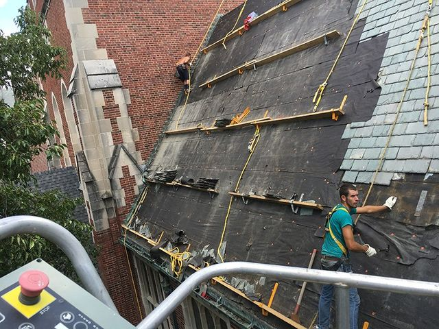 Men repairing the roof