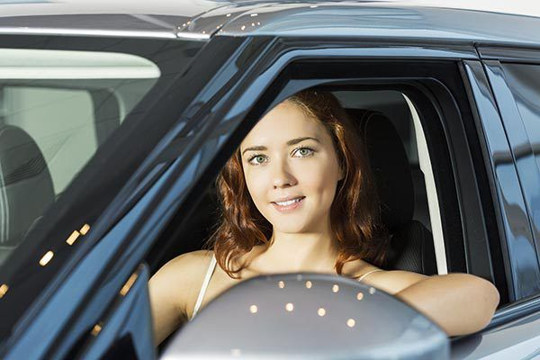 young woman in a maintained car