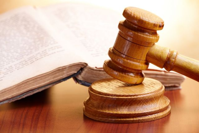 Book and gavel in a estate attorney office for wills and estates planning in Lincoln, NE