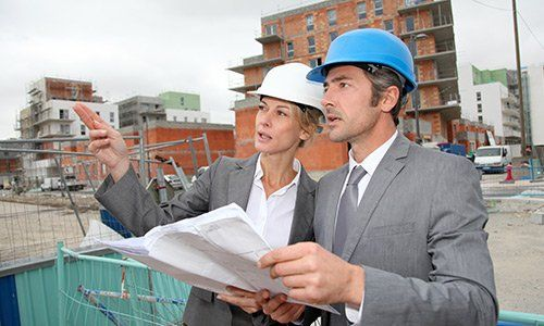 Construction engineers checking plan