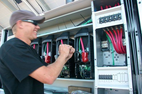 Roland Shackelford checking wiring in Honokaa, HI