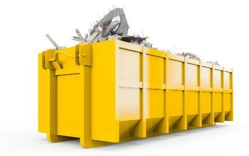 un container giallo con delle macerie