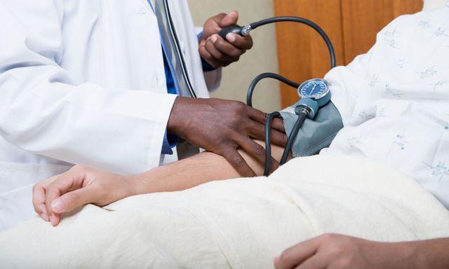 Doctor in Cincinnati taking blood pressure of patient