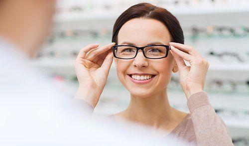 Women trying on glasses