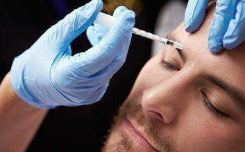 A man having a treatment on his forehead