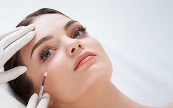 A lady having a facial treatment