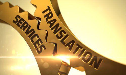 un'immagine di due ingranaggi che si toccano e la scritta Translation Services