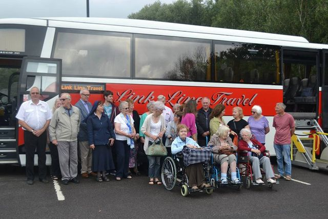 People standing in front of a coach